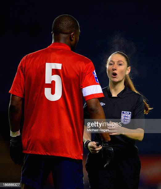Referee Sian Massey speaks to Yann Songo'o of Blackburn during the Barclays U21 Premier League match between Leicester City U21 and Blackburn Rovers...