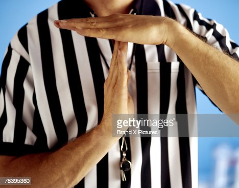 Referee signaling time-out : Stock Photo