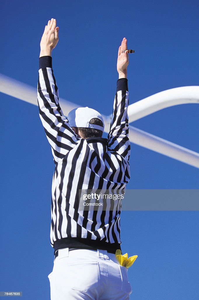 Referee signaling touchdown or successful field goal