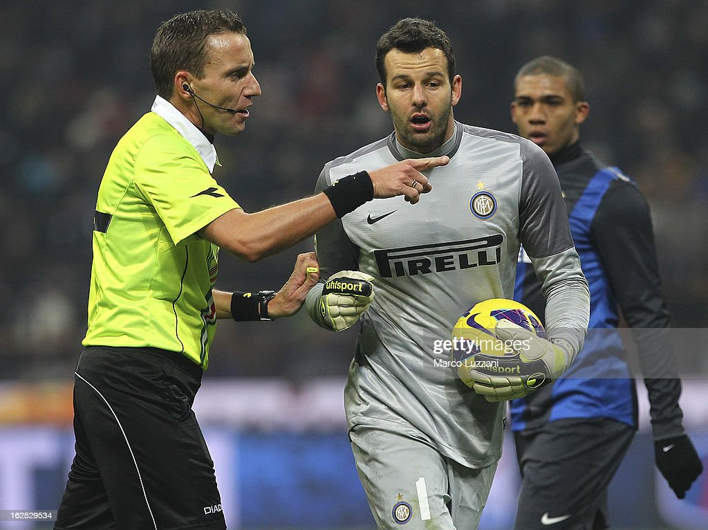 Referee Silvio Mazzoleni disputes with Samir Handanovic of FC Internazionale Milano during the Serie A match FC Internazionale Milano and AC Milan at San Siro Stadium on February 24, 2013 in Milan, Italy.