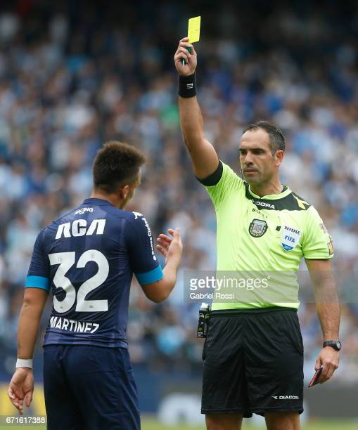 Referee Silvio Trucco gives a yellow card to Lautaro Martinez of Racing Club during a match between Racing and Atletico de Tucuman as part of Torneo...