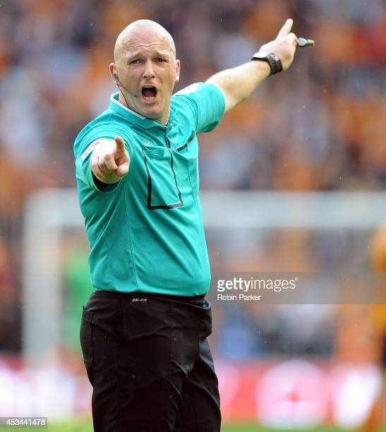Referee Simon Hooper during the Sky Bet Championship match between Wolverhampton Wanderers and Norwich City at the Molineux Stadium on August 10 2014...
