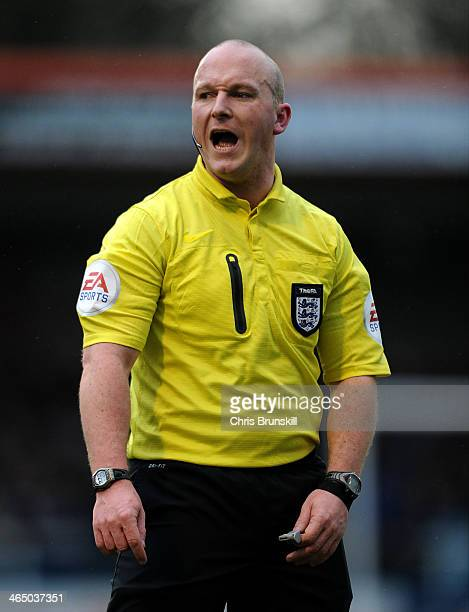 Referee Simon Hooper looks on during the FA Cup with Budweiser Fourth Round match between Rochdale and Sheffield Wednesday at Spotland on January 25...