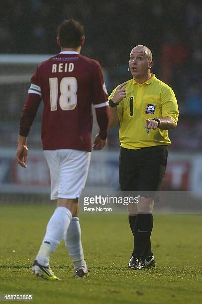 Referee Simon Hooper makes a point to Paul Reid of Northampton Town during the SkyBet League Two match between Northampton Town and Wycombe Wanderers...