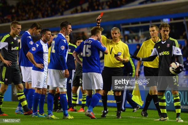 Referee Simon Hooper shows Wade Elliott of Birmingham City a red card during the Capital One Cup Fourth Round match between Birmingham City and Stoke...