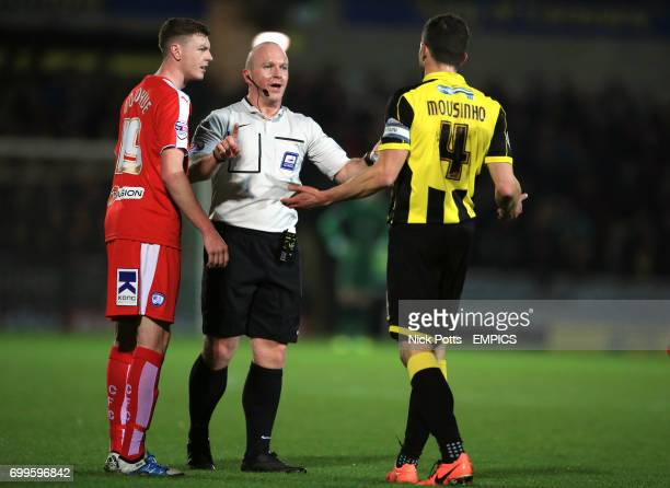 Referee Simon Hooper talks with Chesterfield's Dion Donohue and Burton Albion's John Mousinho