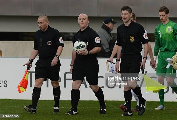 Referee Simon Hooper with his assistants Mark Griffiths and Neil Hair lead out the teams during the England v Belgium U18 International Friendly...