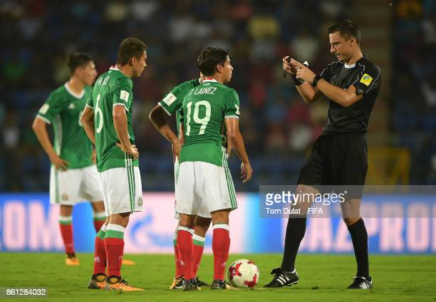 Referee Slavko Vincic gives instructions during the FIFA U17 World Cup India 2017 group E match between Mexico and Chile at Indira Gandhi Athletic...