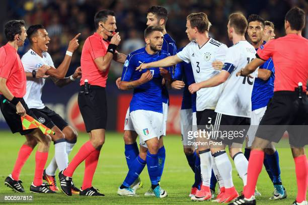 Referee Slavko Vincic intervenes as players clash during the 2017 UEFA European Under21 Championship Group C match between Italy and Germany at...