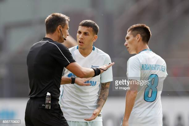 referee Slavko Vincic Leandro Paredes of FC Zenit Matias Kranevitter of FC Zenit during the UEFA Europa League fourth round qualifying first leg...