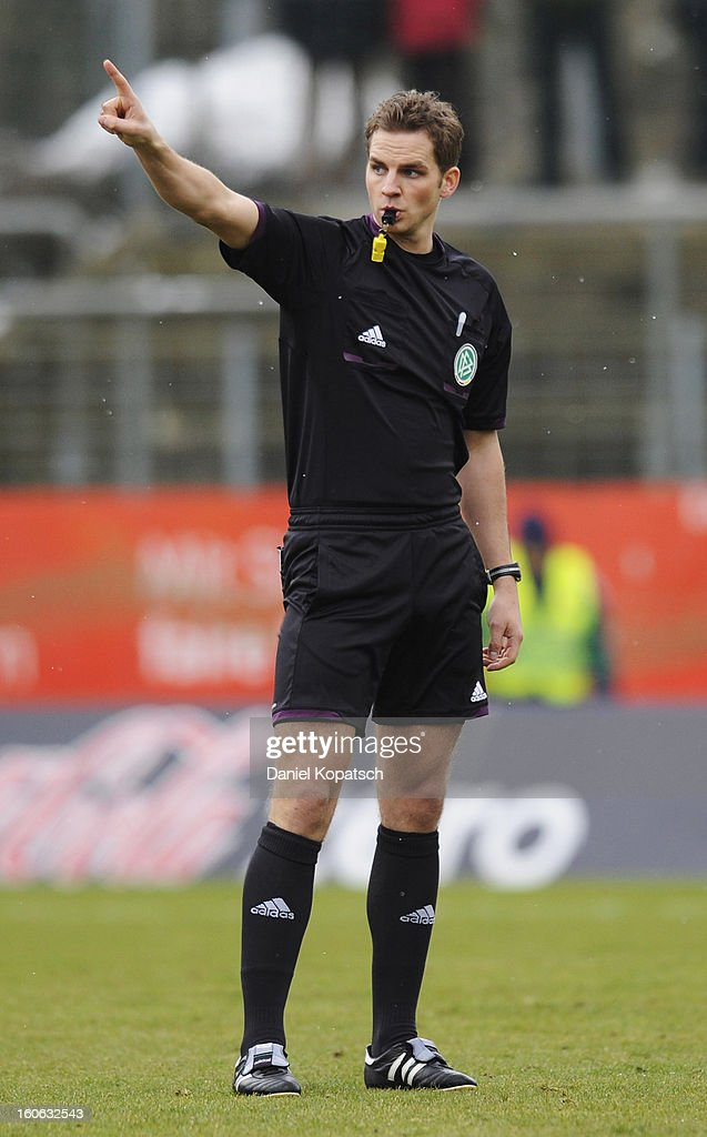 Referee Soeren Storks reacts during the third Bundesliga match between SpVgg Unterhaching and Hallescher FC on February 3, 2013 in Unterhaching, Germany.