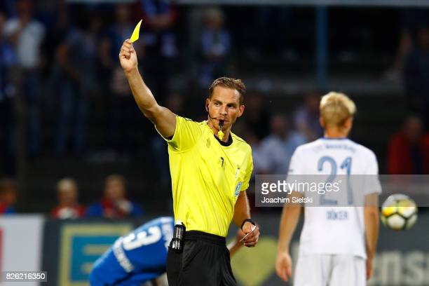 Referee Soeren Storks with the yellow card during the 3 Liga match between SV Meppen and 1 FC Magdeburg at Haensch Arena on August 2 2017 in Meppen...