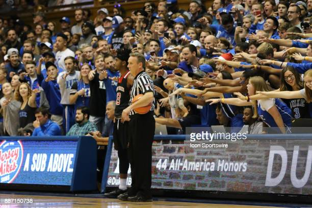 Referee St Francis Red Flash guard Keith Braxton and the Duke Fans during the 1st half of the Duke Blue Devils game versus the StFrancis on December...