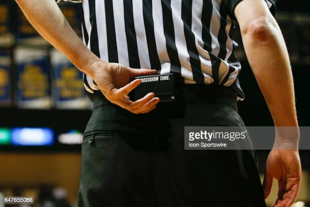A referee starts his timer during a regular season basketball game between the Ball State Cardinals and the Toledo Rockets on February 28 at Savage...