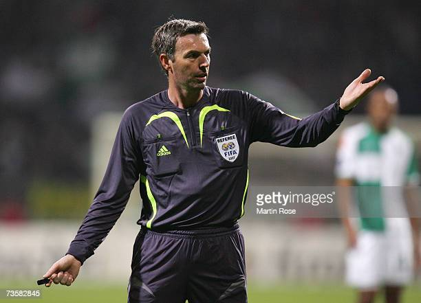Referee Stefano Farina gestures during the UEFA Cup round of sixteen second leg match between Werder Bremen and Celta Vigo at the Weserstadion on...