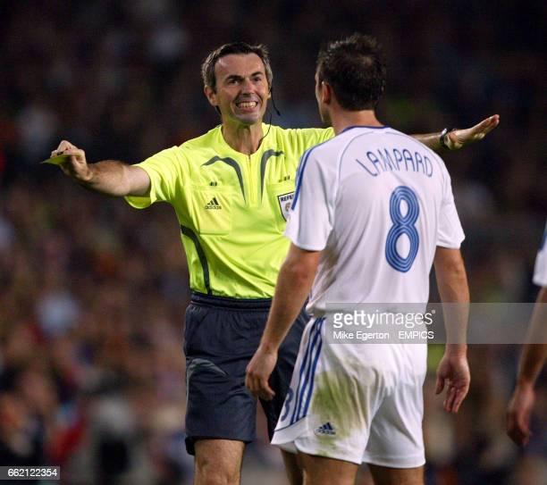 Referee Stefano Farina shares a joke with Chelsea's Frank Lampard
