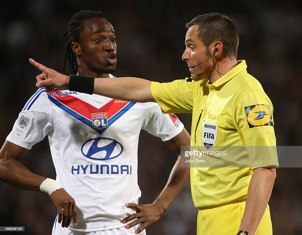 Referee Stephane Lannoy argues with Bakary Kone of Lyon (L) during the Ligue 1 match between Olympique Lyonnais, OL, and Paris Saint-Germain FC, PSG, at the Stade Gerland on May 12, 2013 in Lyon, France.