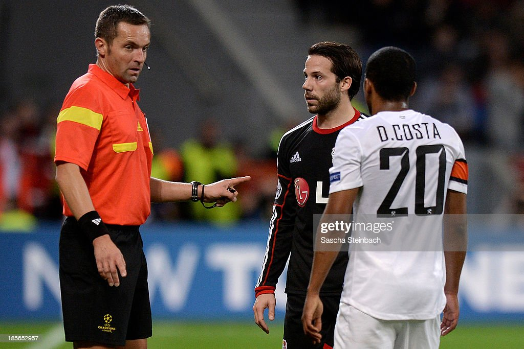 Referee <a gi-track='captionPersonalityLinkClicked' href=/galleries/search?phrase=Stephane+Lannoy&family=editorial&specificpeople=2274380 ng-click='$event.stopPropagation()'>Stephane Lannoy</a> gestures to <a gi-track='captionPersonalityLinkClicked' href=/galleries/search?phrase=Gonzalo+Castro&family=editorial&specificpeople=605388 ng-click='$event.stopPropagation()'>Gonzalo Castro</a> of Leverkusen and <a gi-track='captionPersonalityLinkClicked' href=/galleries/search?phrase=Douglas+Costa+-+Soccer+Forward+born+1990&family=editorial&specificpeople=5672410 ng-click='$event.stopPropagation()'>Douglas Costa</a> of Donetsk during the UEFA Champions League Group A match between Bayer Leverkusen and Shakhtar Donetsk at BayArena on October 23, 2013 in Leverkusen, Germany.