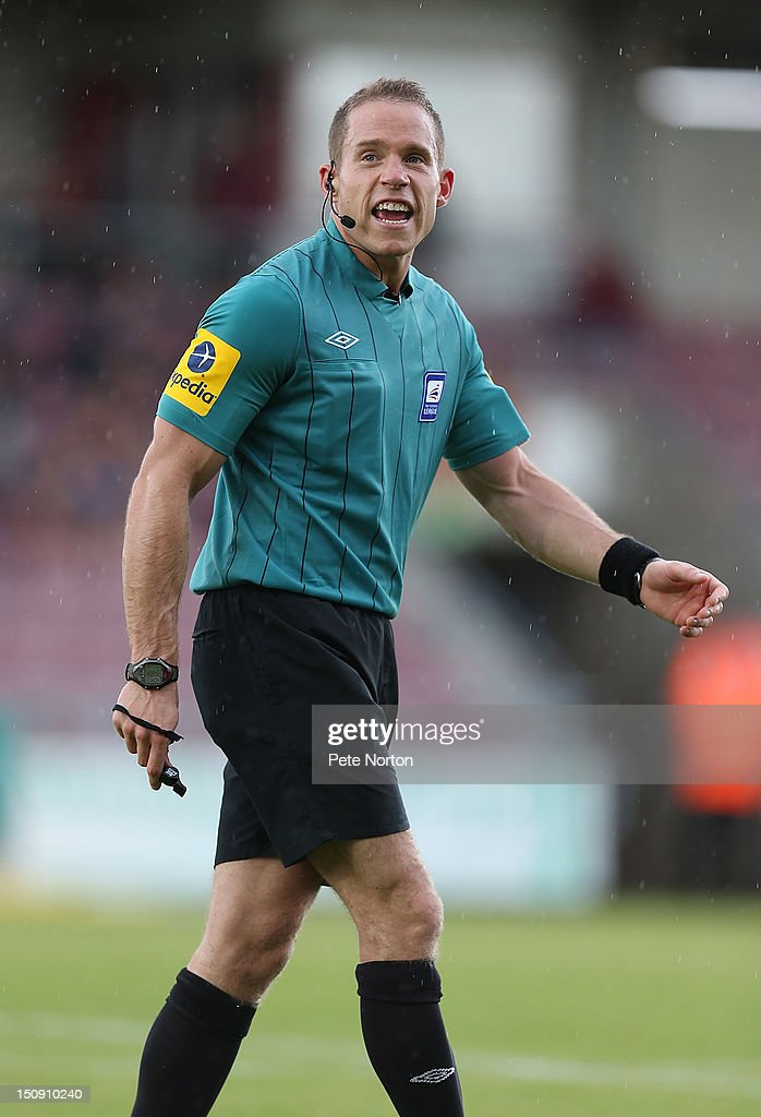 Referee Stephen Martin in action during the npower League Two match between Northampton Town and Southend United at Sixfields Stadium on August 25, 2012 in Northampton, England.