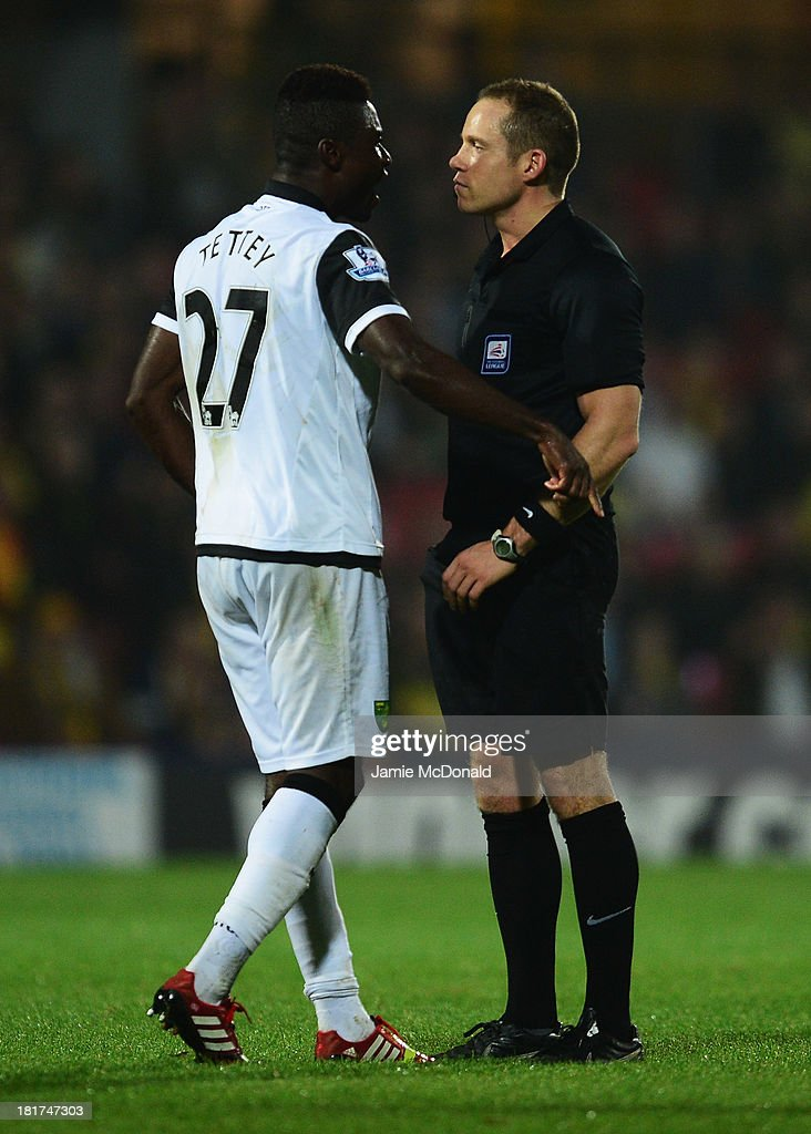 Referee Stephen Martin talks to Alexander Tettey of Norwich City during the Capital One Cup Third Round match between Watford and Norwich City at Vicarage Road on September 24, 2013 in Watford, England.