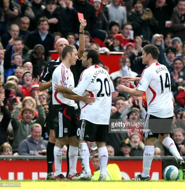 Referee Steve Bennet shows Liverpools Javier Mascherano a red card during the Barclays Premier League match at Old Trafford Manchester