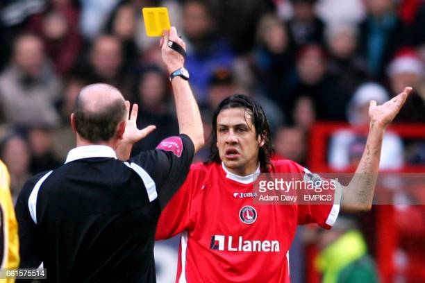 Referee Steve Bennett shows a yellow card to Charlton Athletic's Gonzalo Sorondo