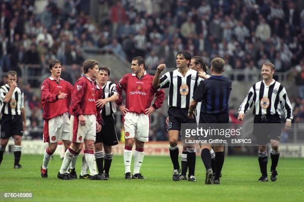 Referee Steve Dunn tries to calm down Newcastle United's Philippe Albert and Manchester United's Ole Gunnar Solskjaer Alan Shearer David Beckham Ole...