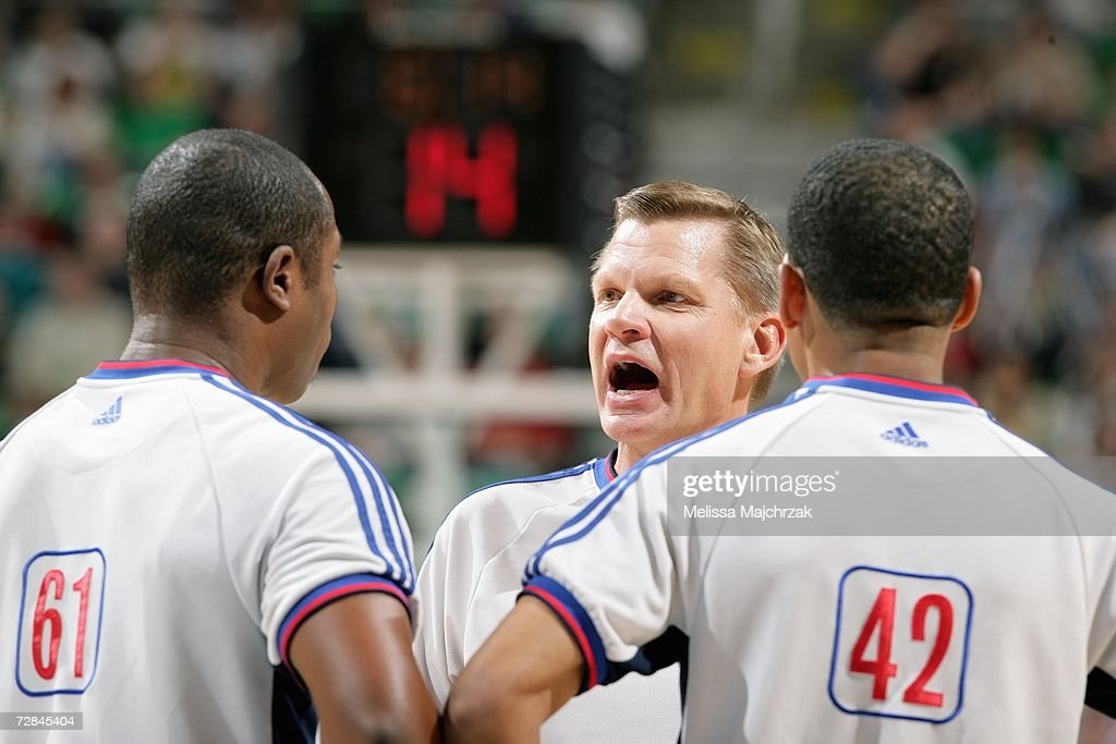 Referee Steve Javie talks to fellow officials Courtney Kirkland and Eric Lewis during the Milwaukee Bucks game against the Utah Jazz at...