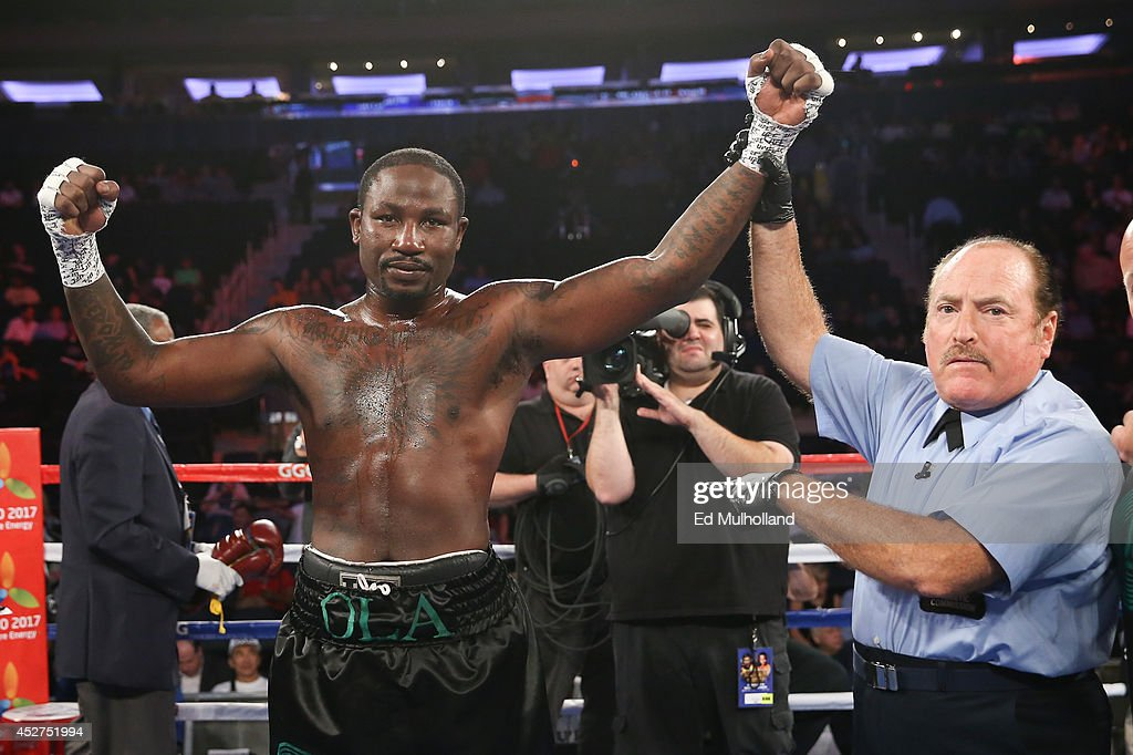 Referee Steve Smoger raises the arm of Ola Afolabi after his knockout win over Anthony Caputo Smith (not shown) during their cruiserweight bout at Madison Square Garden on July 26, 2014 in New York, New York.