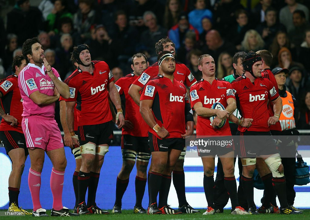 Referee Steve Walsh and the Crusaders view the replay screen during the round 18 Super Rugby match between the Highlanders and the Crusaders at Forsyth Barr Stadium on June 29, 2013 in Dunedin, New Zealand.