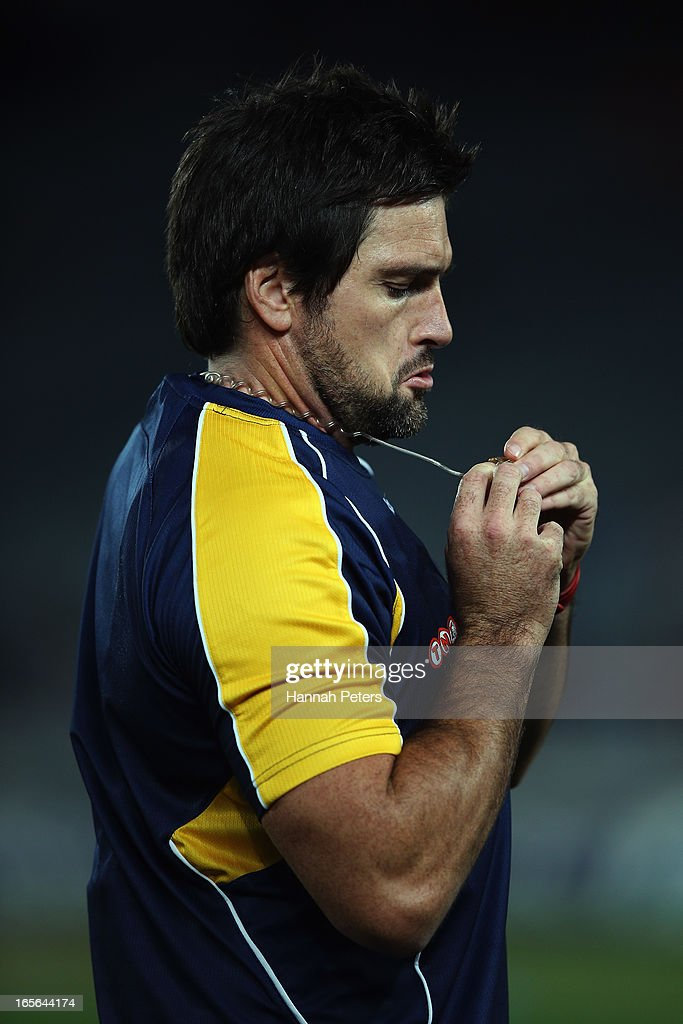 Referee Steve Walsh attaches his ear piece before the round eight Super Rugby match between the Blues and the Highlanders at Eden Park on April 5, 2013 in Auckland, New Zealand.
