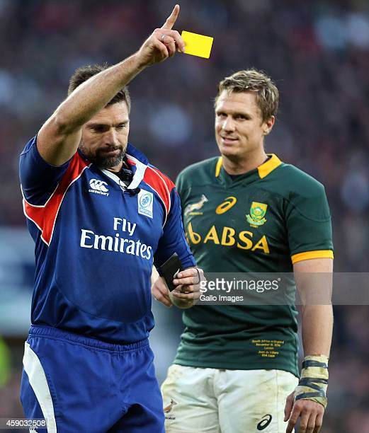 Referee Steve Walsh holds up a yellow card for Dylan Hartley of England during the QBE International match between England and South Africa at...