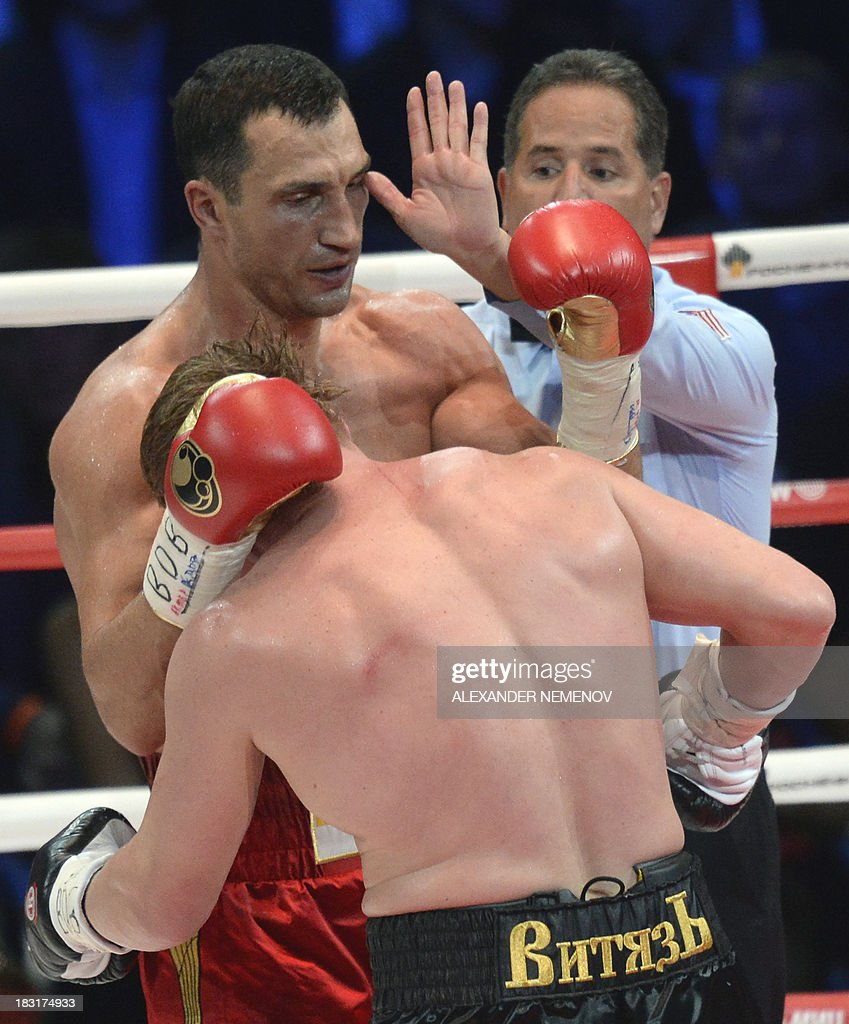 A referee stops Ukrainian heavyweight boxing world champion Vladimir Klitschko (L) fighting with Russian heavyweight boxer Alexander Povetkin in Moscow on October 5, 2013. World heavyweight champion Vladimir Klitschko retained his WBA, IBF, WBO and IBO titles with a unanimous points win over Russia's Alexander Povetkin.