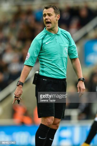 Referee Stuart Attwell gestures during the Premier League match between Newcastle United and Crystal Palace at StJames' Park on October 21 in...