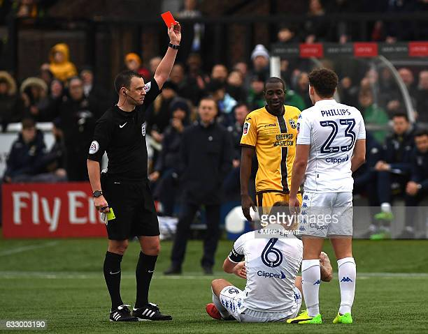 Referee Stuart Attwell gives a red card too Liam Cooper of Leeds United during The Emirates FA Cup Fourth Round match between Sutton United and Leeds...