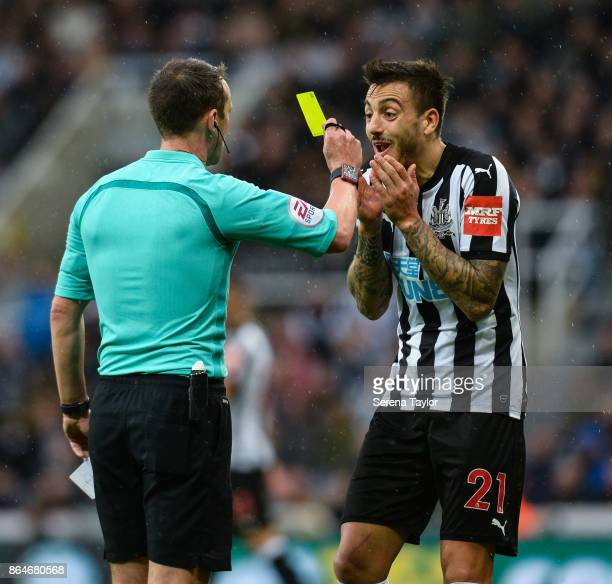 Referee Stuart Attwell gives Joselu of Newcastle United a yellow card during the Premier League match between Newcastle United and Crystal Palace at...