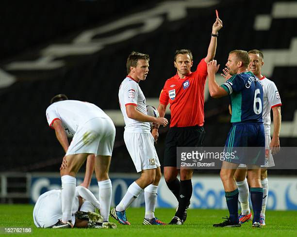 Referee Stuart Atwell shows Lee Cattermole of Sunderland a red card for his challenge on Adam Chicksen of Milton Keynes Dons during the Captial One...