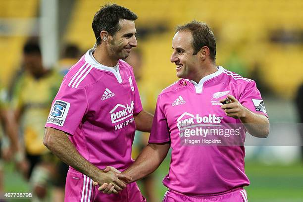 Referee Stuart Berry shakes hands with assistant referee Craig Joubert during the round seven Super Rugby match between the Hurricanes and the Rebels...