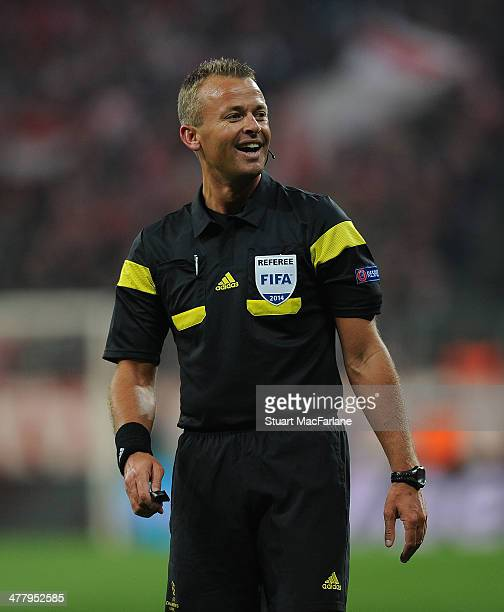 Referee Svein Oddvar Moen during the UEFA Champions League Round of 16 match between FC Bayern Muenchen and Arsenal at Allianz Arena on March 11 2014...