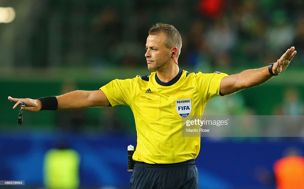 Referee <a gi-track='captionPersonalityLinkClicked' href=/galleries/search?phrase=Svein+Oddvar+Moen&family=editorial&specificpeople=6489051 ng-click='$event.stopPropagation()'>Svein Oddvar Moen</a> signals during the UEFA Champions League Group B match between VfL Wolfsburg and PFC CSKA Moskva at Volkswagen Arena on September 15, 2015 in Wolfsburg, Germany.