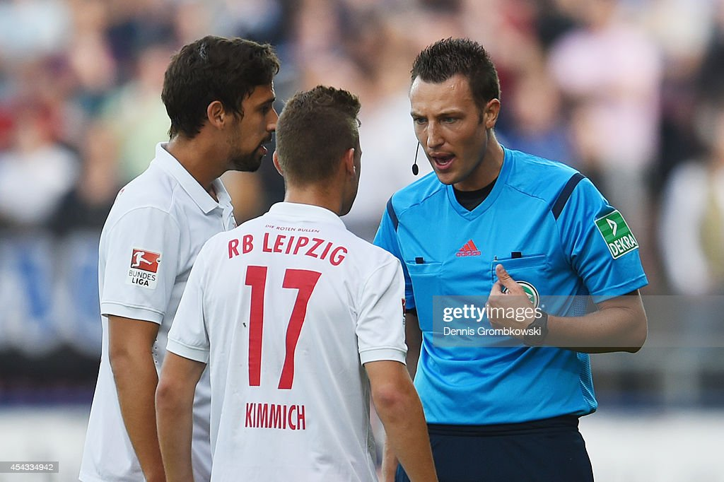 Referee Sven Jablonski urges <a gi-track='captionPersonalityLinkClicked' href=/galleries/search?phrase=Joshua+Kimmich&family=editorial&specificpeople=9479434 ng-click='$event.stopPropagation()'>Joshua Kimmich</a> of RB Leipzig during the Second Bundesliga match between FSV Frankfurt and RB Leipzig at Volksbank Stadion on August 29, 2014 in Frankfurt am Main, Germany.