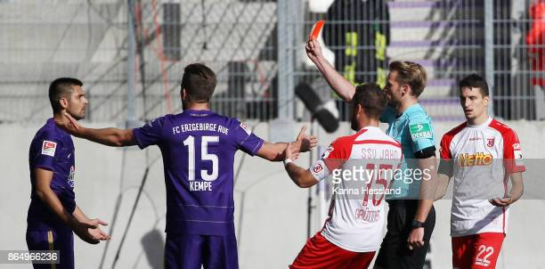 Referee Sven Waschitzki shows the red card to Dimitrij Nazarov of Aue after throw the ball on Sebastian Stolze of Regensburg during the Second...