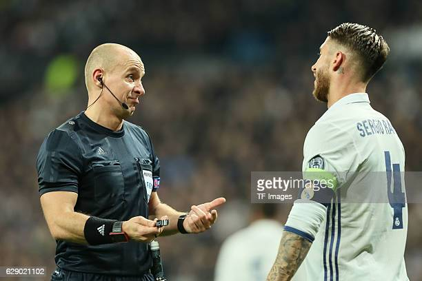 referee Szymon Marciniak and Sergio Ramos of Real Madrid gestures during the UEFA Champions League match between Real Madrid CF and Borussia Dortmund...