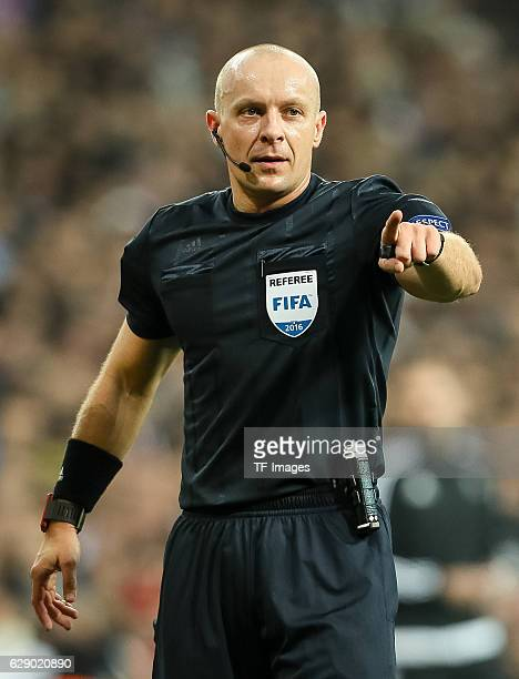 referee Szymon Marciniak gestures during the UEFA Champions League match between Real Madrid CF and Borussia Dortmund at Bernabeu on December 7 2016...