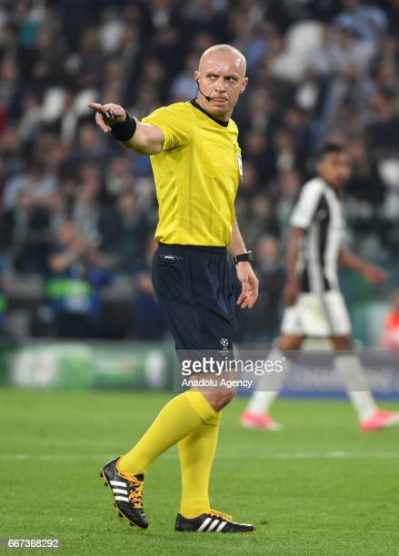 Referee Szymon Marciniak gestures during the UEFA Champions League Round of 4 first leg match between FC Juventus and Barcelona FC at Juventus...