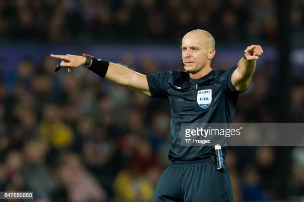 Referee Szymon Marciniak gestures during the UEFA Champions League match between Feyenoord Rotterdam and Manchester City at Stadion Feijenoord on...