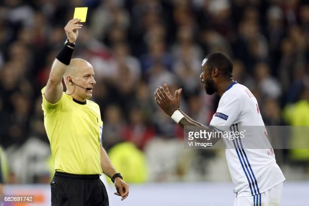 referee Szymon Marciniak Nicolas Nkoulou of Olympique Lyonnaisduring the UEFA Europa League semi final match between Olympique Lyonnais and Ajax...