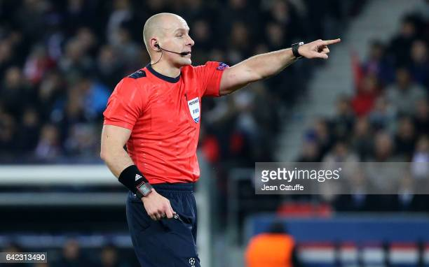 Referee Szymon Marciniak of Poland gestures during the UEFA Champions League Round of 16 first leg match between Paris SaintGermain and FC Barcelona...