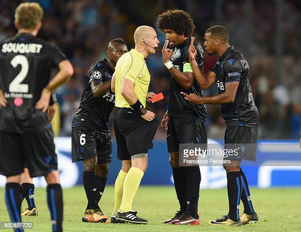 Referee Szymon Marciniak shows the red card to Alassane Plea during the UEFA Champions League Qualifying PlayOffs Round First Leg match between SSC...