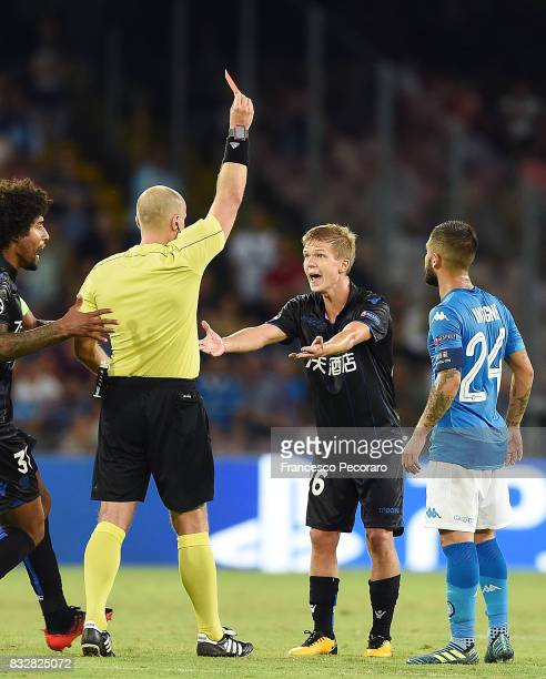 Referee Szymon Marciniak shows the red card to Vincent Koziello during the UEFA Champions League Qualifying PlayOffs Round First Leg match between...
